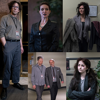 The environment is bleak. The characters are bleak. So is the clothing. Muted greens and greys abound, with an occasional splash of black. We use a palette of sickness and bruises. On lower level staff members, the fit is poor and the clothes are unflattering. As we reach the executives, the fit is better, but we never forget where we are.