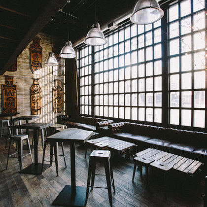Where can you find taxidermy crows, skulls, wooden mannequins, and a whiskey straight up?