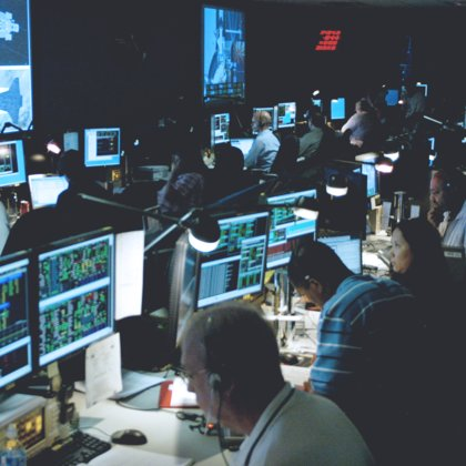 The main control room overlooks the launch room, in which sits the time travel Capsule. The two are separated by a large window. Steam vents from the multitude of hoses connected to it to the pod.