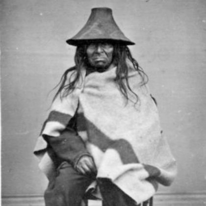 In this photo we see a Coast Salish man posing with his Cedar Hat and Blanket; using Hope we will recreate this moment in time.