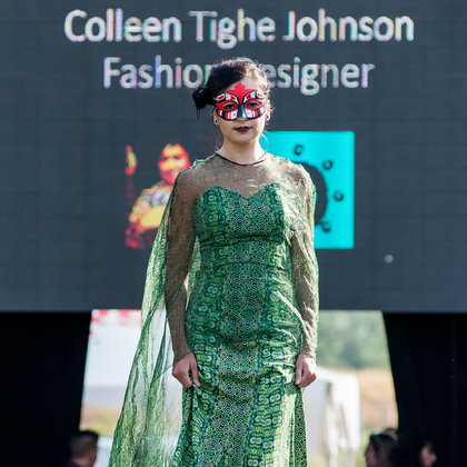 Australian fashion designer Collen Tighe Johnson shows her collection at the World Fusion of Wearable Art Fashion Show. Hand painted mask by local artist Erik Prytula.