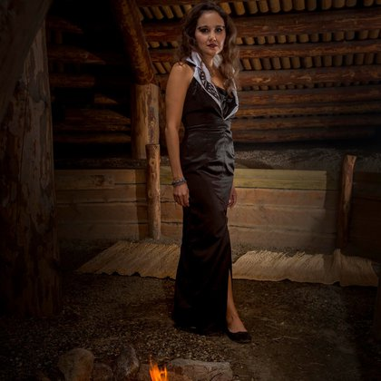 Model Tanya Pellett stands in a traditional Pithouse in a Linda Kay Peters design from Ringing Bell Robes in Hope BC.