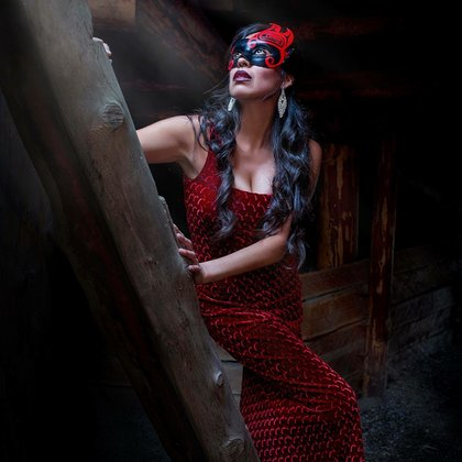 Model Heather Lewis in the traditional Pithouse of the Secwepemc people. Wearing a hand painted mask by Kamloops artist Erik Prytula.