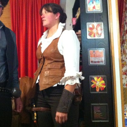 The Bar Owner Sandra Tate.This outfit is the look I see for her (except the plastic gun in the thigh holster).  And probably even that actress. Kathryn Hudepohl.