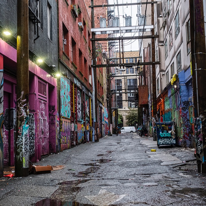 The back alleys of the Downtown Eastside can be ominous, even dangerous, places, filled with dirty needles, people selling and buying drugs, shooting up, or smoking meth and crack. Evanna Brennan and Susan Giles are unafraid; they will search the back alleys looking for patients who are in urgent need of care, such as those who are HIV-positive and need their daily dose of antiretroviral drugs.