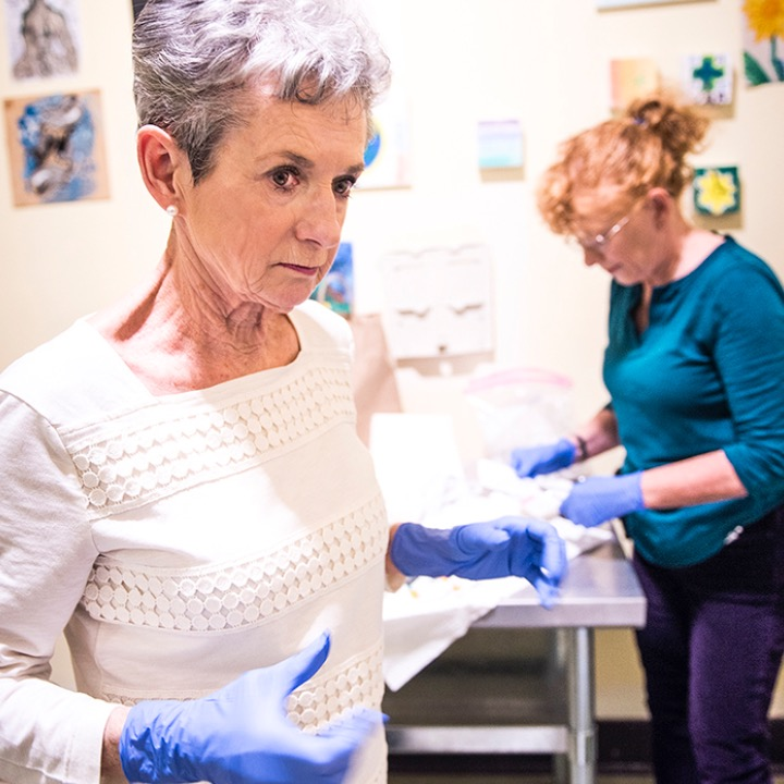 Without nursing support from Evanna Brennan and Susan Giles, their patients would suffer greatly, possibly even die, from a malady called venous sclerosis. Common to injection drug users and caused by dirty needles, this condition is characterized by festering ulcers. Brennan and Giles clean and rebandage these wounds on a regular basis, ensuring the patient doesn't develop further infections in other parts of the body that travel from these suppurative injuries.